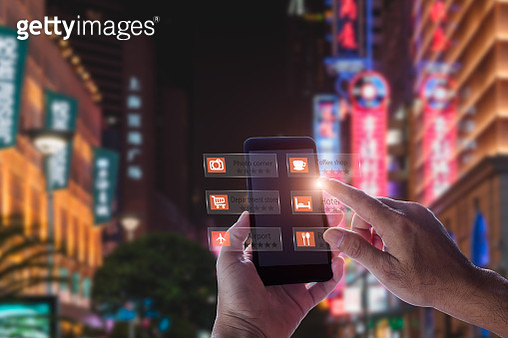 Hand holding smart phone use AR application to check relevant information about the spaces around customer. - gettyimageskorea