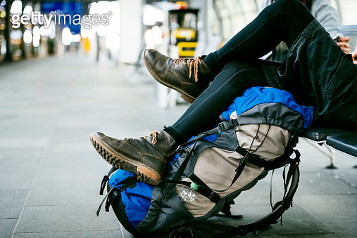 Closeup of young backpackers relaxing at the Airport - gettyimageskorea