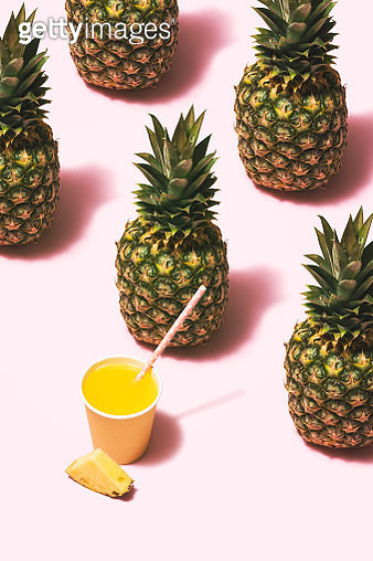 Pineapple juice flat lay on pink background - gettyimageskorea