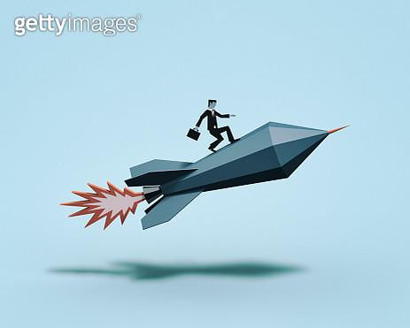Businessman surfing on rocket - gettyimageskorea