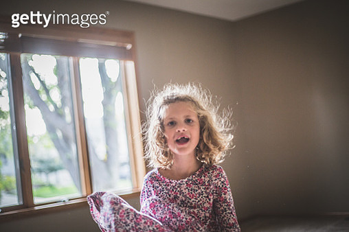 Happy Curly Haired Girl - gettyimageskorea