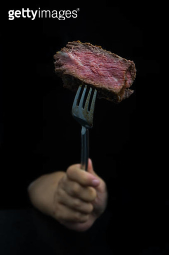hand use Fork  cut tenderloin beef steak - gettyimageskorea