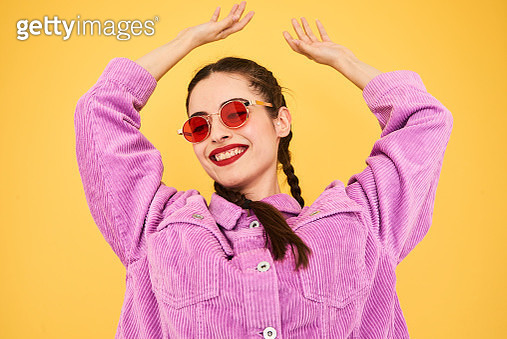 Colourful studio portrait of a young woman - gettyimageskorea