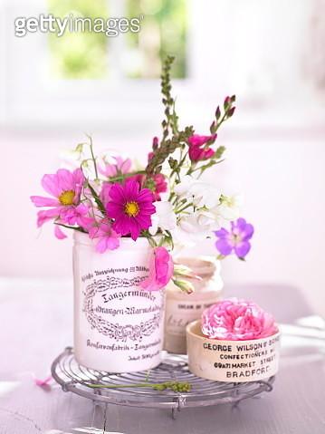 Colourful bouquet in jam pots - gettyimageskorea