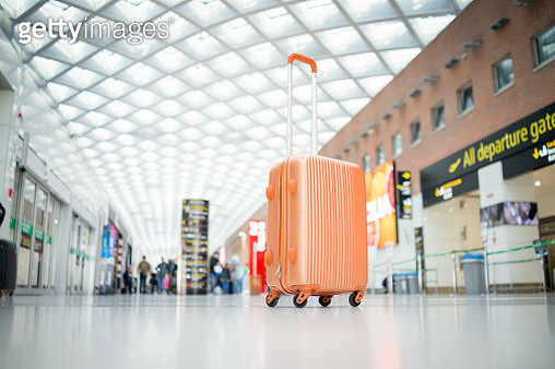 Suitcase at airport - gettyimageskorea