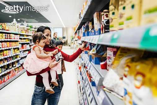 Mother Holding Daughter While Shopping - gettyimageskorea