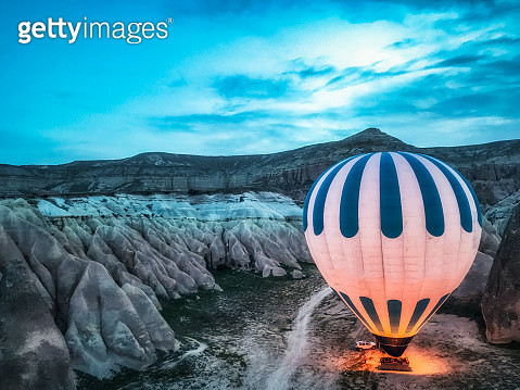 Mobile device photo of a hot air balloon preparing to fly in Cappadocia, Turkey. The area is a popular tourist destination, as it has many areas with unique geological, historic, and cultural features.   The photo was taken by mobile device on 28/05/2018. - gettyimageskorea
