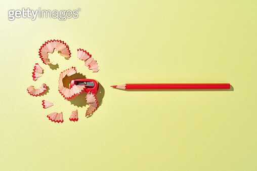 Red Crayon Pencil and Shavings on Green Colored Background Directly Above View. - gettyimageskorea