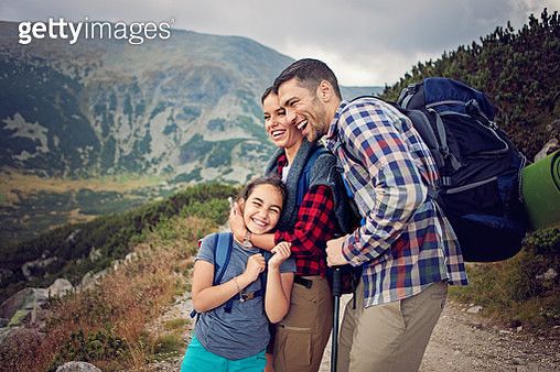 Happy family is hiking in the mountain - gettyimageskorea