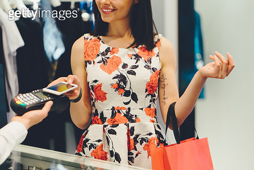 Young woman shopping contactless with mobile phone - gettyimageskorea