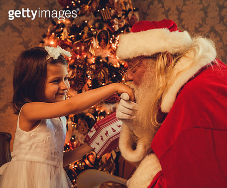 Santa Claus gives presents - gettyimageskorea