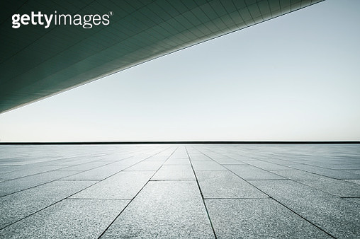Wide open marble platform under roof for automobile commerical - gettyimageskorea
