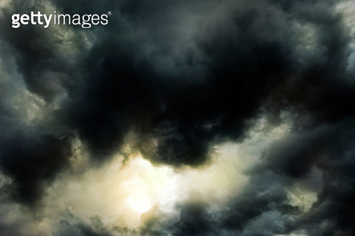 Sun breaking through clouds after storm - gettyimageskorea