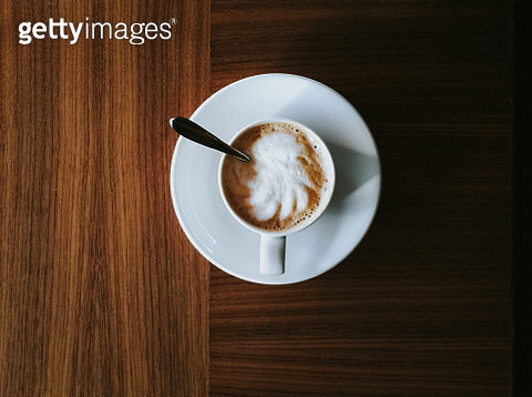 A cup of cappuccino top view, on wooden table - gettyimageskorea