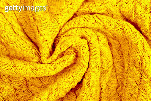 Knitted sweater as a trendy bright illuminating yellow colour background. - gettyimageskorea