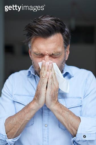 Man blowing nose - gettyimageskorea