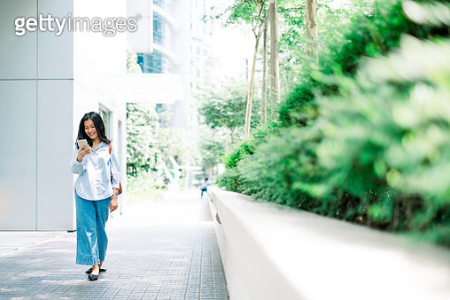 Portrait of Young Businesswomen Using Mobile Phone - gettyimageskorea
