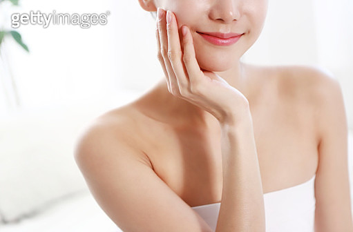 Woman with Hand on Face - gettyimageskorea