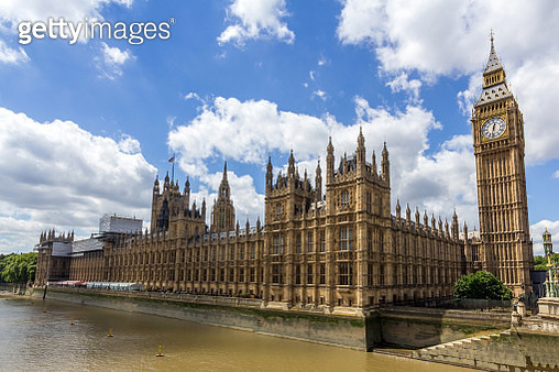 House of Commons and Palace of Westminster next to Thames river in London. - gettyimageskorea