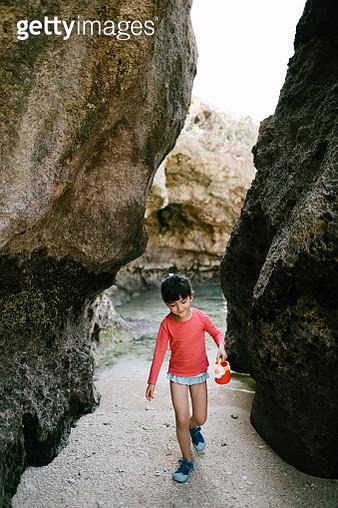 Adorable preschool girl playing on beach in cave, Okinawa, Japan - gettyimageskorea