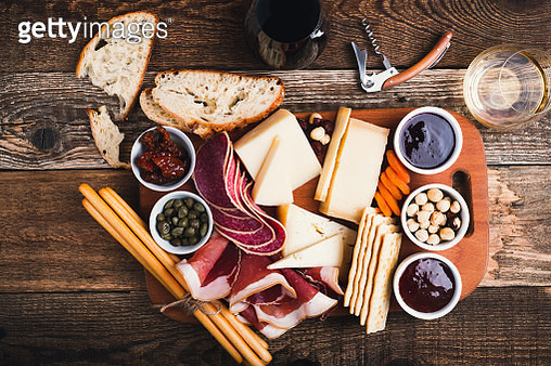 Snack finger food on cutting board with cheese, bread and meat viewed from above - gettyimageskorea