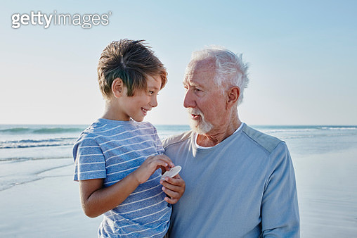 Grandfather with grandson on the beach - gettyimageskorea