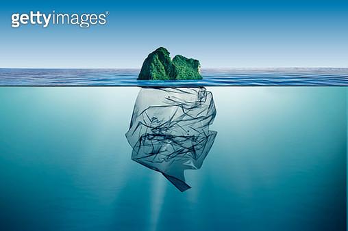 garbage plastic with island floating in the ocean - gettyimageskorea