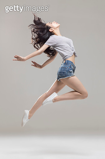 Happy young woman dancing - gettyimageskorea