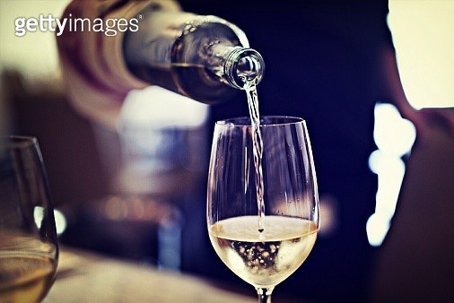 Midsection Of Waiter Pouring Wine In Glass At Restaurant - gettyimageskorea